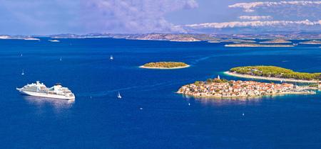 cruising: Adriatic tourist destination of Primosten aerial panoramic archipelago view, with cruiser ship, Dalmatia, Croatia