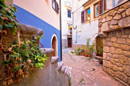 Colorful paved street of old adriatic town Vrbnik, Island of Krk, Kvarner bay archipelago of Croatia