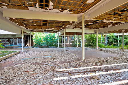 destructed: Krk, Croatia, August 31 2017: Abandoned and destructed luxury hotel Palace Haludovo in Malinska, Island of Krk, Croatia. In 1970s and 1980s it was the most exclusive hotel in Eastern Europe. Editorial