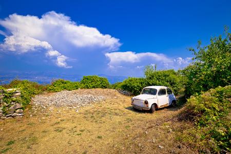 Old fashion car wreck in nature in Skrip vilage on Brac island, Dalmatia, Croatia