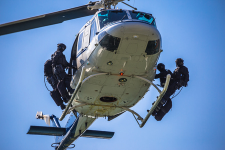unmarked: Special forces team ready for helicopter rope jumping, unmarked and unrecognizable swat team