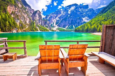 Relax deck chair by Braies lake in Alps, South Tyrol, Italy