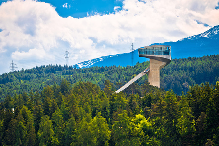 Alpine hills of Insbruck and olympic ski jump tower view, capital of Tyrol, Austria Stock Photo
