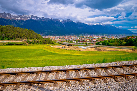Panoramic aerial view of Innsbruck and Hafelekarspitze mountain with railroad tracks, Tyrol state of Austria