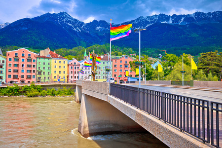 Colorful Innsbruck architecture and Inn river view, LGBT flags on the pole, Alps region of Tyrol, Autria Stock Photo