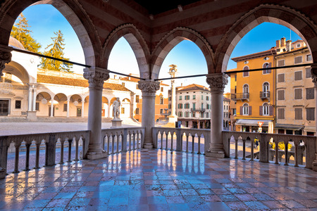 Ancient Italian square arches and architecture in town of Udine, Piazza della Liberta square, Friuli Venezia Giulia region of Italy
