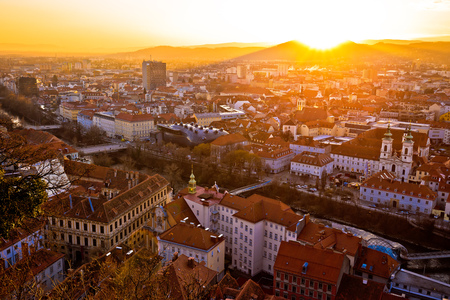Graz city center aerial view at burning sunset, Styria region of Austria