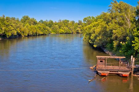 Mura river ferry boat and green landscape, Medjimurje region of Croatia Stock Photo