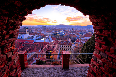 Graz city center and Mur river aerial burning sunset view, Styria region of Austria