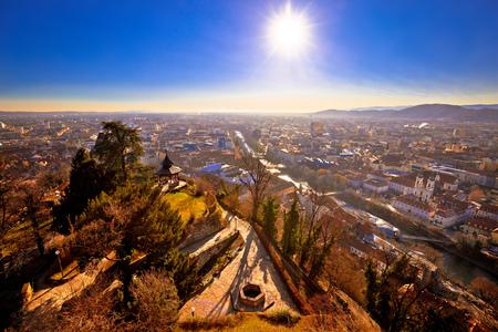 Graz city center and Mur river aerial sunset view, Styria region of Austria