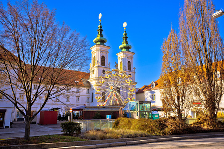 Mur river coast and church in Graz view, Steiermark region of Austria