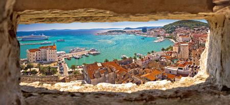 Split waterfront aerial panoramic view through stone window, Dalmatia region of Croatia Stockfoto