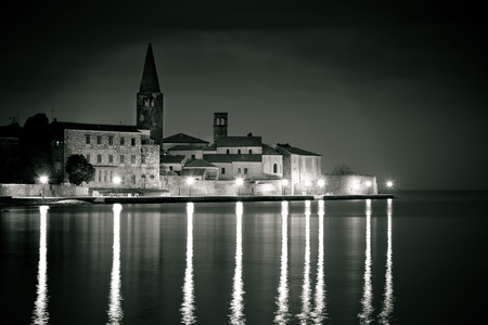 Town of Porec coast evening black and white view, UNESCO landmark in Istria, Croatia Stock Photo