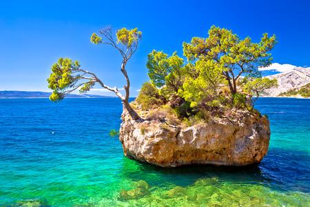 Idyllic islet on Punta Rata beach in Brela, Makarska riviera of Dalmatia, Croatia