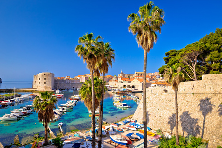 Dubrovnik colorful harbor view from Ploce gate, old town walls in Dalmatia region of Croatia Stock Photo