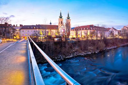 City of Graz Mur river and island evening view, Styria region of Austria Stock Photo