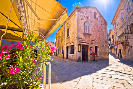 Sunny stone street of ancient Pula view, Istria region of Croatia