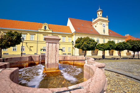 Old paved street and fountain in Tvrdja historic town of Osijek, Slavonija region of Croatia