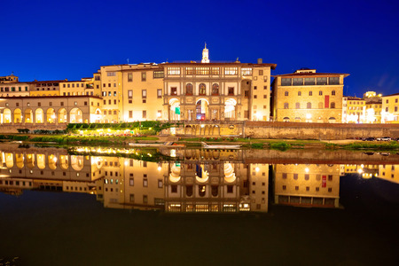 Arno river waterfront evening reflections in Florence, Tuscany region of Italy Stock Photo