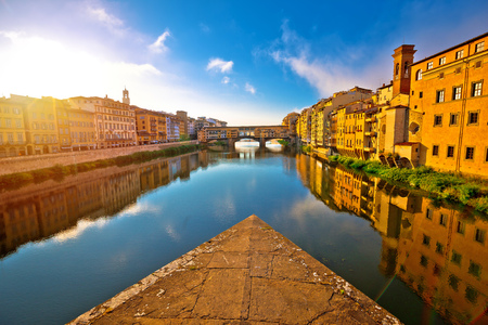 Ponte Vecchio bridge and Florence waterfront sunrise view, Tuscany region of Italy