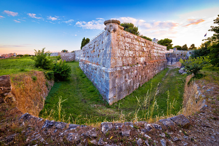 Defense stone walls and trench in Pula view, fortification in Istria region of Croatia Reklamní fotografie