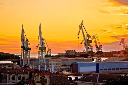 Town of Pula shipyard cranes sunset view, Istria region of Croatia