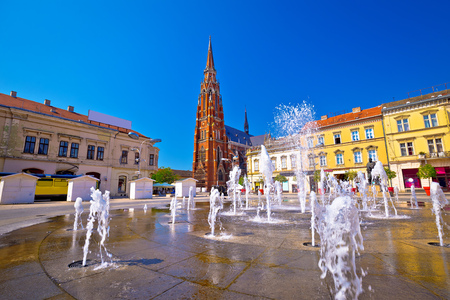 Osijek main square fountain and cathedral view, Slavonija region of Croatia