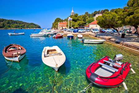 Turquoise waterfront and colorful boats in town of Cavtat, Town in south Dalmatia, Croatia