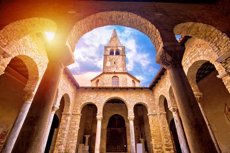 Euphrasian Basilica in Porec arcades and tower sun haze view