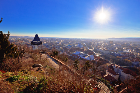 Uhrturm landmark and Graz cityscape aerial view, Styria region of Austria 版權商用圖片
