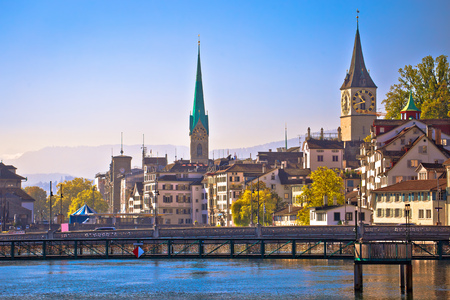 Zurich idyllic waterfront and towers view, largest city in Switzerland