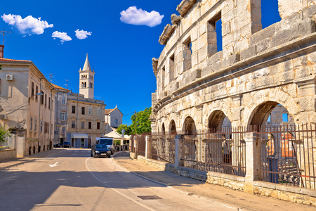 Arena Pula historic Roman amphitheater arches and church view, Istria region of Croatia Banco de Imagens