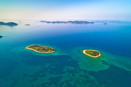 Two lonely stone islands in Zadar archipelago aerial view, Dalmatia region of Croatia Stockfoto