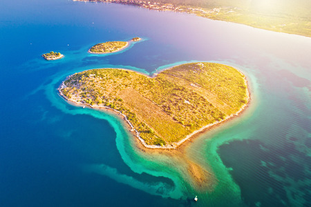 Heart shaped island of Galesnjak in Zadar archipelago aerial view, Dalmatia region of Croatia