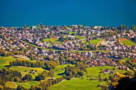 Hergiswil village and Lake Luzern aerial view from mount Pilatus, landscape of Switzerland