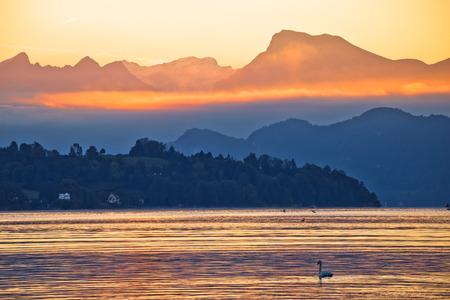 Lake Luzern and Rigi mountain peak morning golden glow view, landscape of Switzerland