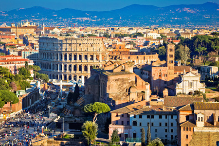 Ancient Roman Forum landmarks and Colosseum in eternal city of Rome, capital of Italy Banco de Imagens