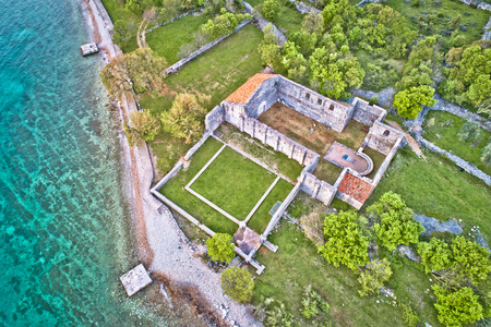 Island of Krk Fulfinum Mirine basilica ruins near Omišalj aerial view, Kvarner bay of Croatia