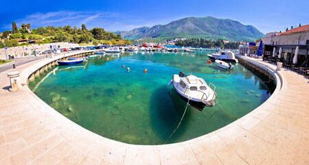 Colorful turquoise harbor in town of Cavtat panoramic view, southern Dalmatia coastline of Croatia