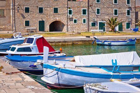 Old stone houses aon Krapanj island waterfront, sea sponge harvesting village, Sibenik archipelago of Croatia