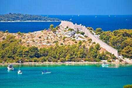 Ancient wall of Ostrica in Grebastica bay view, Dalmatia region of Croatia Stock Photo