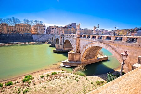 Ancient Ponte Sant Angelo stone bridge on Tiber river of Rome, capital of Italy
