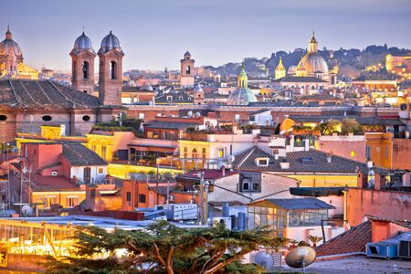 Colorful rooftops of Eternal city of Rome at dusk view, capital of Italy Reklamní fotografie