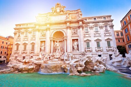Majestic Trevi fountain in Rome sun haze view, eternal city, capital of Italy