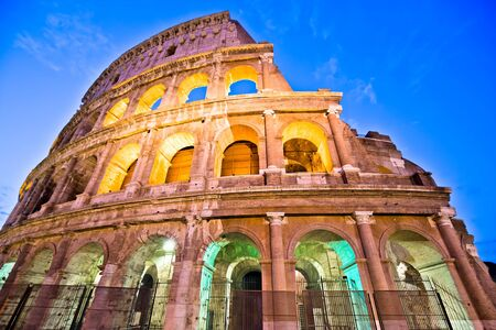 Majestic Colosseum of Rome evening colorful view, famous landmark of eternal city, capital of Italy