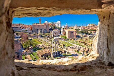 Scenic aerial stone window view over the ruins of the Roman Forum in Rome, capital of Italy
