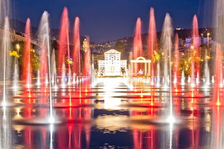 City of Nice cityscape and Fontaine Miroir d eau park evening view, Alpes-Maritimes region of France