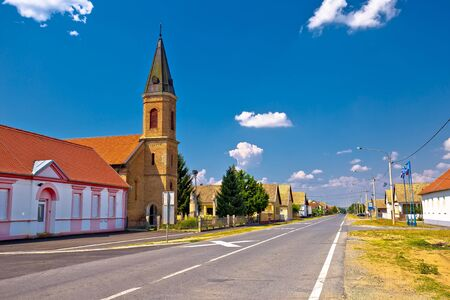 Street view of Karanac church and historic architecture, ethno village in Baranja region of Croatia