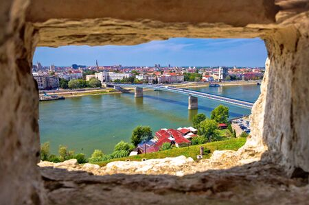 City Of Novi Sad and Danube river aerial view through stone window from Petrovaradin, Vojvodina region of Serbia