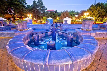 Subotica city fountain square evening view, Vojvodina region of Serbia